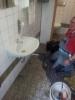 Reparatur der Toiletten und der eingetretenen Tür am 08.06 (1)